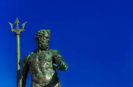 Neptune God of the Sea bronze statue with trident, from the Fountain of Neptune, erected in 1566 in the historic center of Bologna (with copy space) Banque d'images