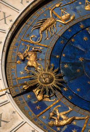 Ancient time and Astrology. Detail of Saint Mark Square renaissance Clock Tower in Venice with zodiac signs, planet and stars (15th century)