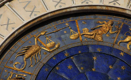 Ancient time and Astrology. Detail of Saint Mark Square renaissance Clock Tower in Venice with zodiac signs Scorpio, Libra Virgo, planet and stars (15th century)