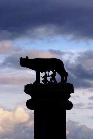 Legendary Capitoline Wolf with royal twins at the top of Capitol Hill in Rome, against beautiful clouds Banque d'images