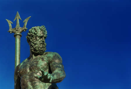 Neptune God of the Sea bronze statue with trident, from the Fountain of Neptune, erected in 1566 in the historic center of Bologna (with copy space) Standard-Bild