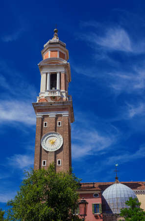 Church of the Holy Apostles of Christ baroque bell and clock tower among clouds in Venice, completed in the 18th century Banque d'images