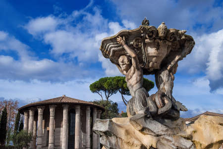 Fountain of the Tritons,beautiful baroque fountain completed in 1715, and the ancient Temple of Hercules Victor, in the center of Forum Boarium square, in Rome