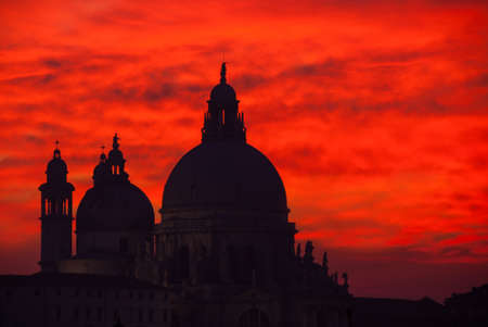 Red blood sky sunset over Venice Lagoon with Salute Basilica domes
