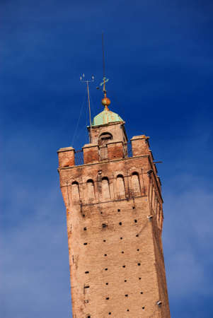 Detail of the top of medieval Asinelli Tower, the tallest tower in Bologna and the symbol of the city, erected at the end of 12th century