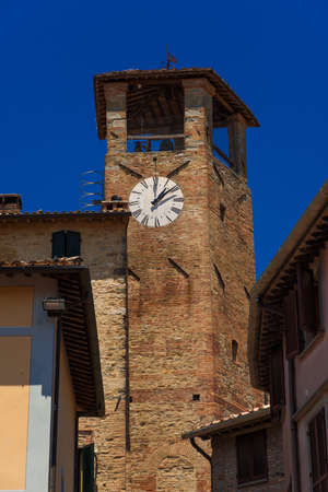 Medieval Clocktower in the historic center of Montone, a small town in the Umbria countryside in Italy