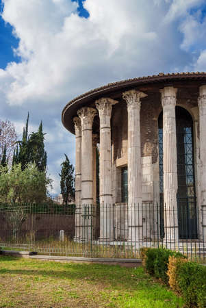 Ancient round Temple of Hercules Victor, the ancient surviving marble building in Rome, erected in Forum Boarium in the 2nd century BC Stock Photo