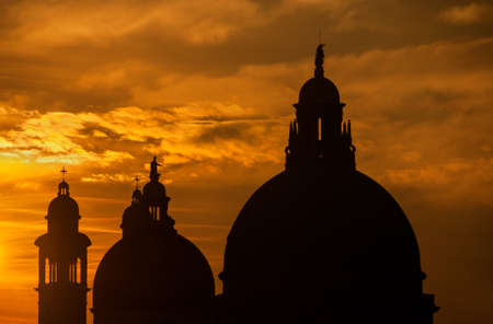 Salute Basilica (Saint Mary of Helath) old domes at sunset in Venice Stock Photo