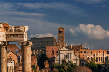 View of the Roman Forum and Coliseum at sunset Stock Photo