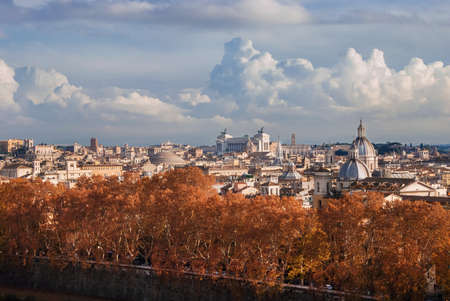 Rome historic center autumn or winter skyline view, with famous landmarks, ancient monuments, old church domes and clouds
