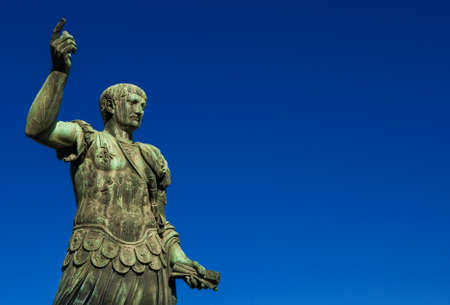 Trajan the conqueror, one of the greatest  ancient roman emperor, bronze statue along Imperial Fora avenue in the very center of Rome (with copy space) Stock Photo