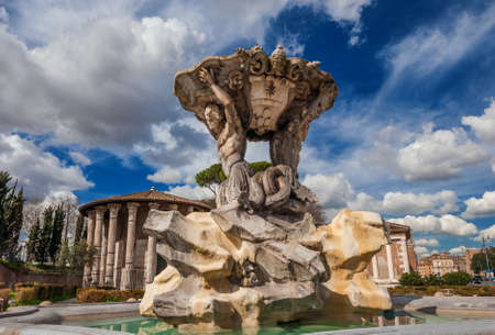 Fountain of the Tritons between the ancient roman  Temples of Hercules Victor and Portunus, in the center of Forum Boarium square, in Rome Banco de Imagens