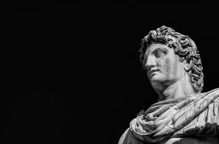 Ancient marble statue of mythical character Castor or Pollux, dated back to the 1st century BC, located at the top of monumental balustrade in Capitoline Hill, in Rome (Black and White with copy space)