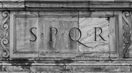 The symbol of ancient Roman Republic carved on the Capitoline Hill monumental marble balustrade (Black and White)
