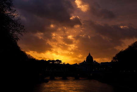Beautiful sunset over River Tiber in Rome historic center with St Peter dome