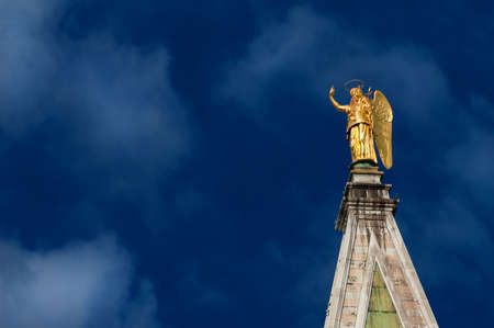 Golden angel statue with blue sky, at the top of Saint Mark Bell Tower in Venice, erected in 1820 (with copy space)