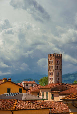 Lucca old  historic center skyline with medieval tower and cloudy sky