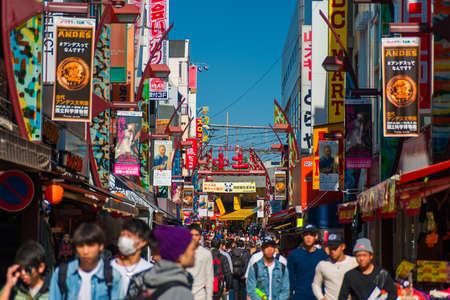 Tokyo, Japan, October 27, 2017: People strolling along the famous Ameyoko shopping street in Ueno District