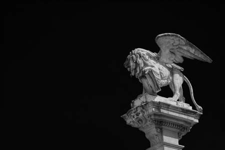 Saint Mark Lion statue, symbol of ancient Republic of Venice, made in 1870 at the of a column in 'Piazza dei Signori' (Lord's Square) in the center of Padua (Black and White with copy space)