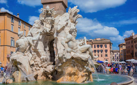 Rome, Italy, September 6, 2015: Tourists visit the Piazza Navona square with beautiful baroque Fountain of Four Rivers