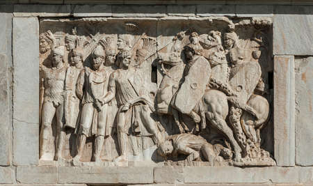 Rome, Italy, April 1, 2018: Relief of a battle between Roman legion and barbarian, from the Arch of Constantine marble panel, in the center of Rome (2nd century AD)