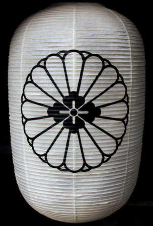 Traditional Japanese Chochin paper lantern with chrysanthemum emblem