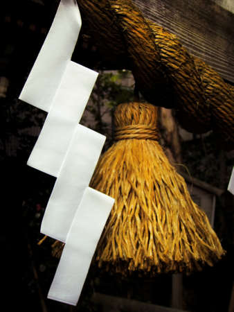 Shide (paper streamers) and Shimenawa (straw rope), traditional ritual objects found at the entrace of Japanese Shinto shrines Reklamní fotografie