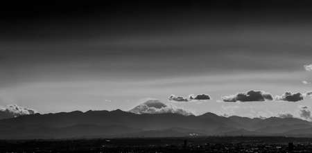 Iconic Mount Fuji wrapped in clouds like and old painting, seen from Tokyo in Japan (Black and White) Reklamní fotografie