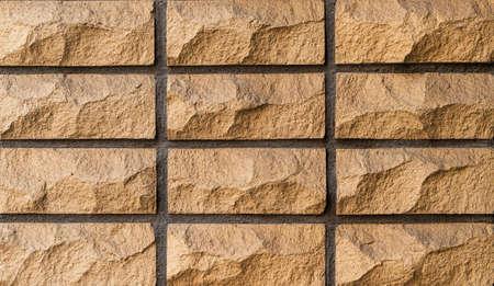 Yellow stone blocks wall as background