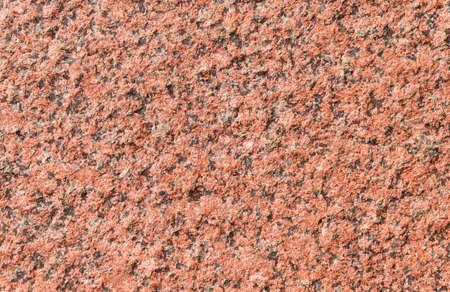 Orange granite wall with quarts as background