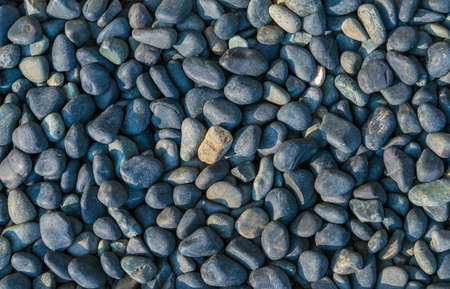 Azure or bluish stone pebbles as background