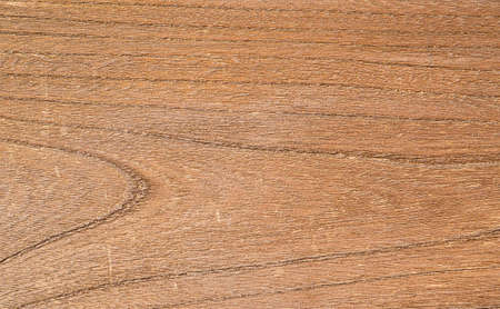 Old brown wooden plank with rough surface as background