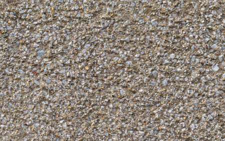 Concrete wall with gravel rough surface as background Reklamní fotografie - 122722084