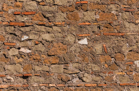 Composite old stone wall with rough surface as background Reklamní fotografie