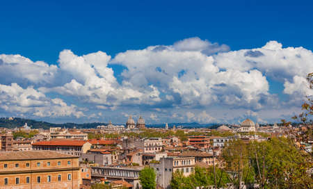 Rome historic center old skyline above Trastevere with old churches, belltowers, domes and clouds, seen from Aventine Hill Reklamní fotografie