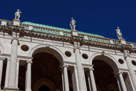 Wonderful Basilica Palladiana marble arches and statues (16th-17th century) in Vicenza with blue sky, designed by the famous renaissance architect Andrea Palladio