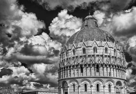 Pisa Baptistry medieval dome with clouds and city ancient walls (Black and White) Reklamní fotografie