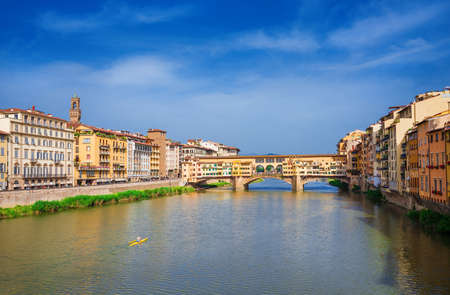 View of the famous Ponte Vecchio (Old Bridge) over River Arno in the historic center of Florence
