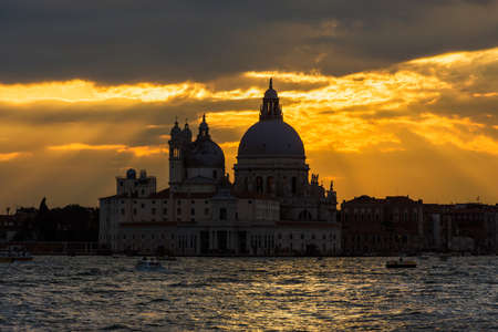 Beautiful Salute Basilica (Saint Mary of Health) old domes at sunset in Venice 版權商用圖片
