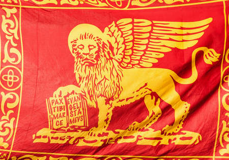 Old Venice Republic Flag with Saint Mark Lion and motto Pax tibi Marce, evangelista meus (Peace be with thee, O Mark, my evangelist) as background Reklamní fotografie