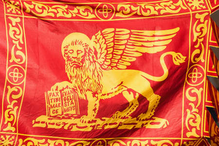 Old Venice Republic Flag with Saint Mark Lion and motto Pax tibi Marce, evangelista meus (Peace be with thee, O Mark, my evangelist) fluttering in the wind as background 版權商用圖片