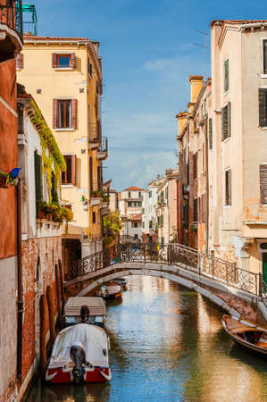 View of a characteristic Venice canal and old traditional houses