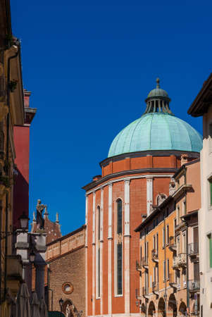 View of Vicenza Cathedral apse with dome designed by the famous architect Andrea Palladio in the 16th century and blue sky (with copy space above)