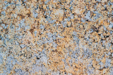 Yellow and grey granite wall with quarts and smooth surface as background