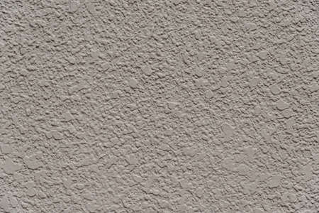 Grey concrete wall with rough surface as background