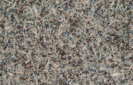 Multicolor granite wall with quarts and rough surface as background