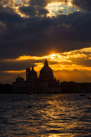 Beautiful sunset over Venice Lagoon and Saint Mary of the Health Basilica