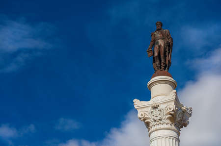 Pedro IV King of Portugal among clouds in Lisbon. Bronze statue at the top of monumental column erected in the cente of Rossio Square in 1874 (with copy space) 版權商用圖片