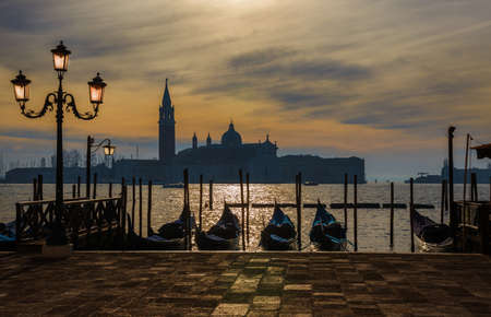 View of winter sunset sky with mist over Saint George Island in Venice Lagoon from city waterfront 版權商用圖片