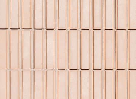 Orange rectangular tiles wall with rough surface as background Reklamní fotografie